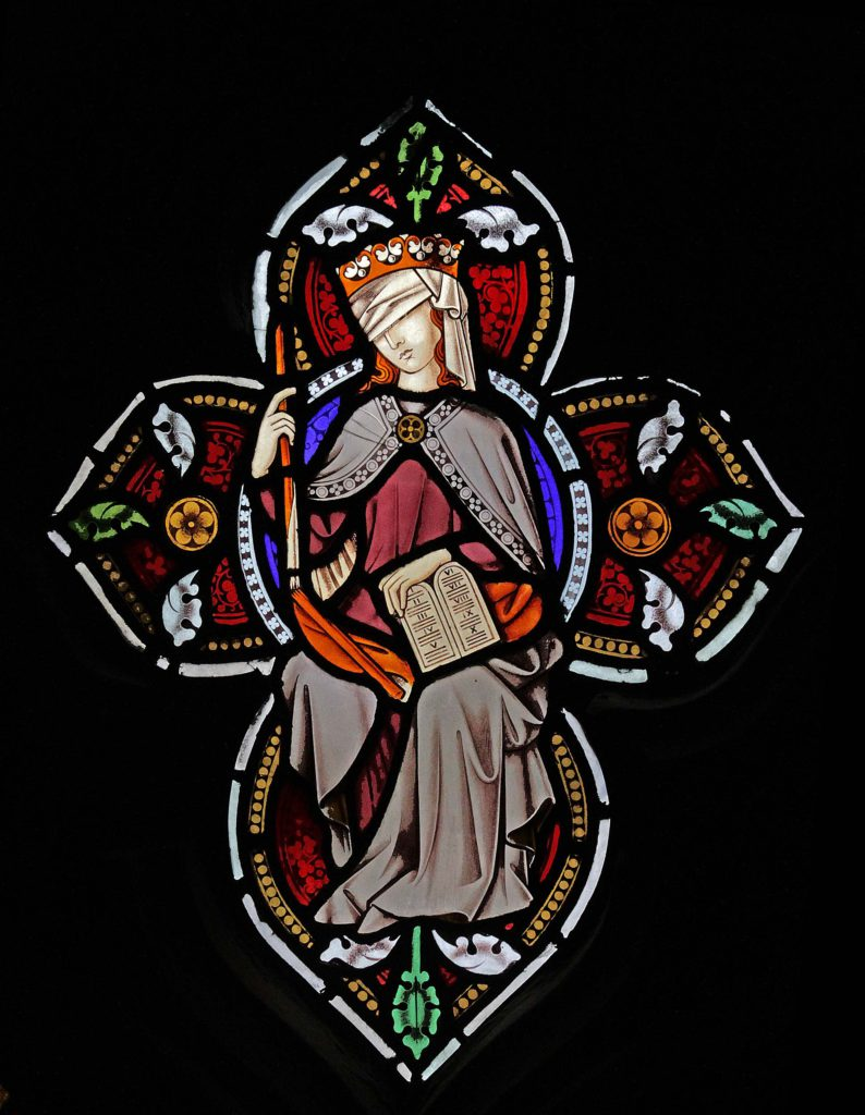Image of Justice in the tracery of St Marie's West Window